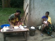 the 2 daughters, making chapatti / caring for her niece